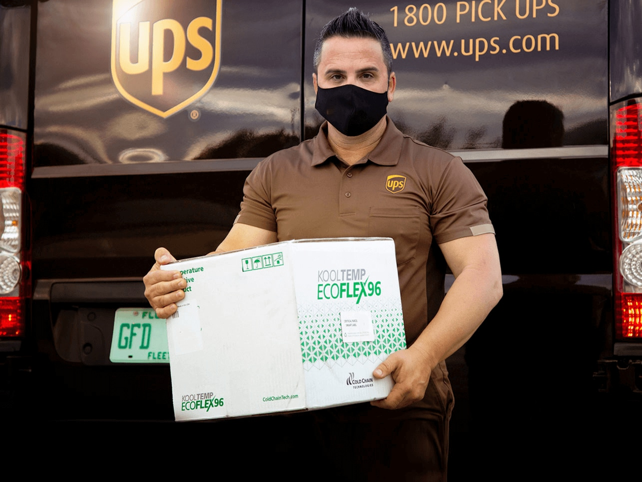 UPS driver delivering an early morning package of vaccines to a hospital