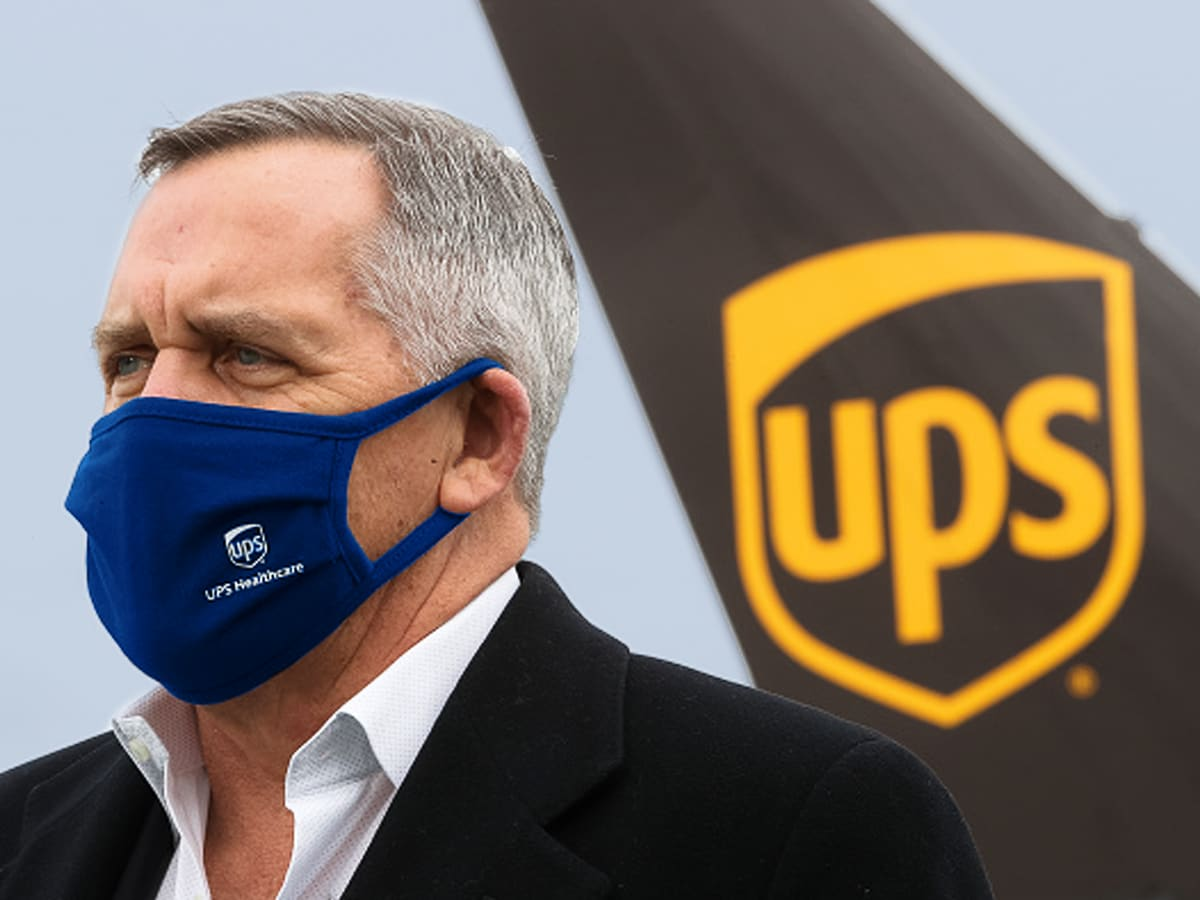 UPS president Wes Wheeler in front of a UPS plane carrying COVID-19 vaccines.