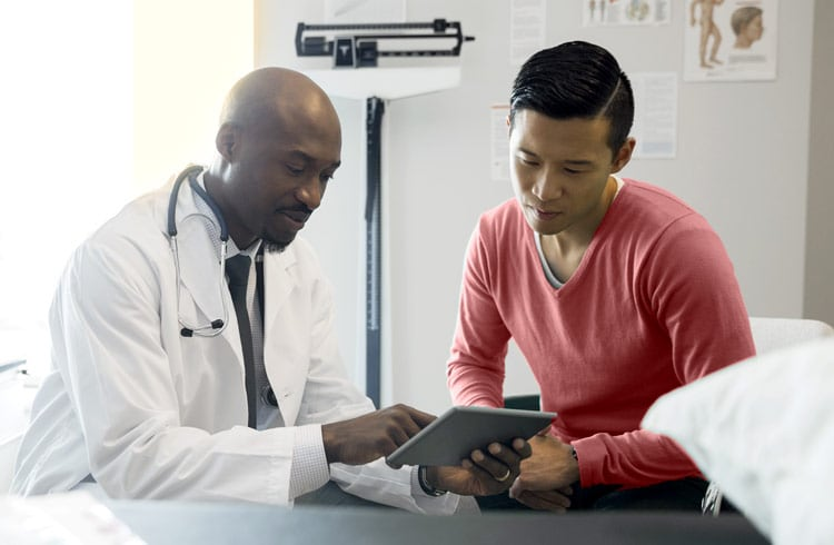 A doctor going over results with a patient