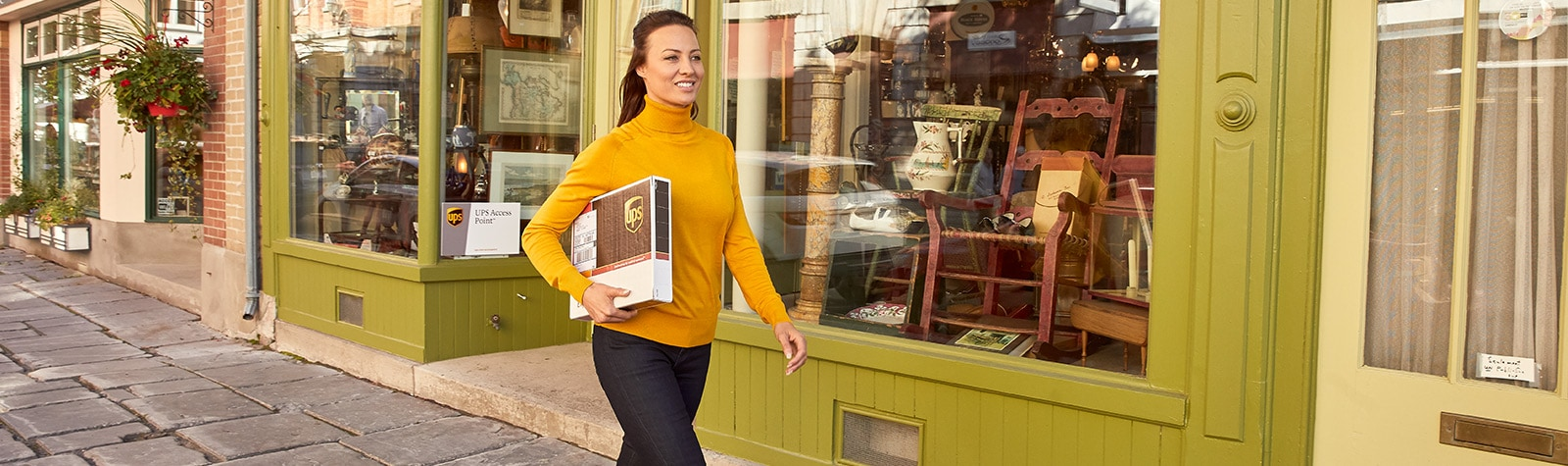 Woman carrying UPS package