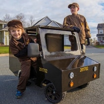 Cooper and Jax are about to take Cooper's new mini UPS delivery truck for a drive.