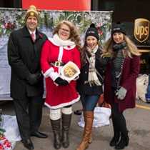 UPS sales male employee, female dressed like Mrs. Clause, and 2 females representing Mary Kay Cosmetics Ltd.