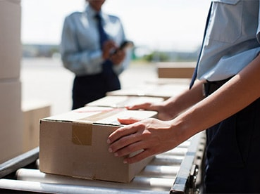 Customs agents handling international deliveries