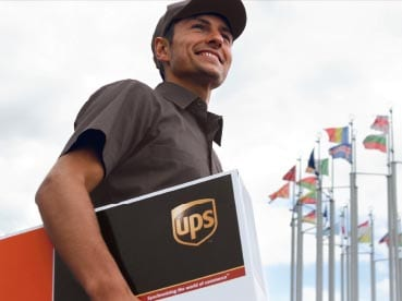 Male courier carrying UPS parcel
