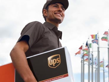 Courier with a UPS package in his hand