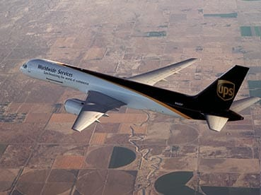 A UPS plane carrying freight goods during a flight.