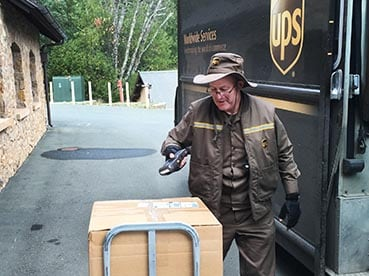 UPS driver scanning parcel for return