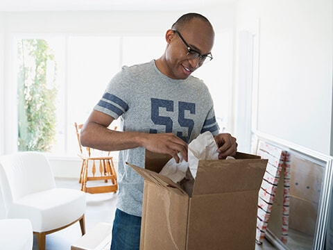 Man opens parcel arrived from home delivery service