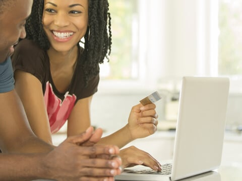 Smiling woman creating an online package delivery request