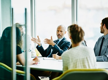 Business people talking around a conference table