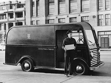 A UPS employee delivers a package.