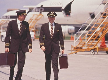 UPS Airlines pilots walking near a UPS jet.