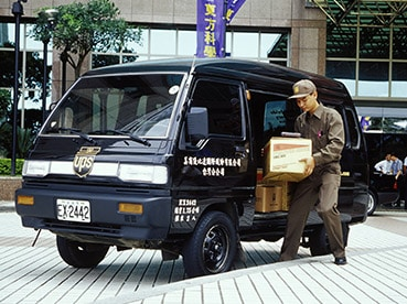 A UPS vehicle and employee in Taiwan.