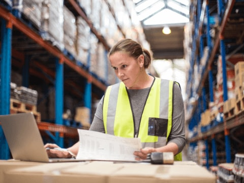 An employee watches supply chain progress