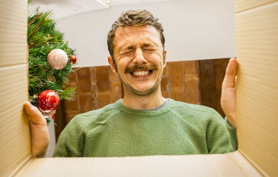Surprised man looking at gift