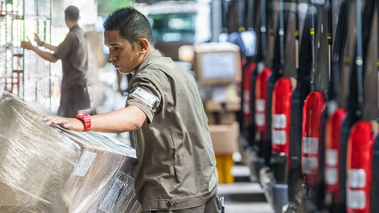 Man handling a package in a warehouse