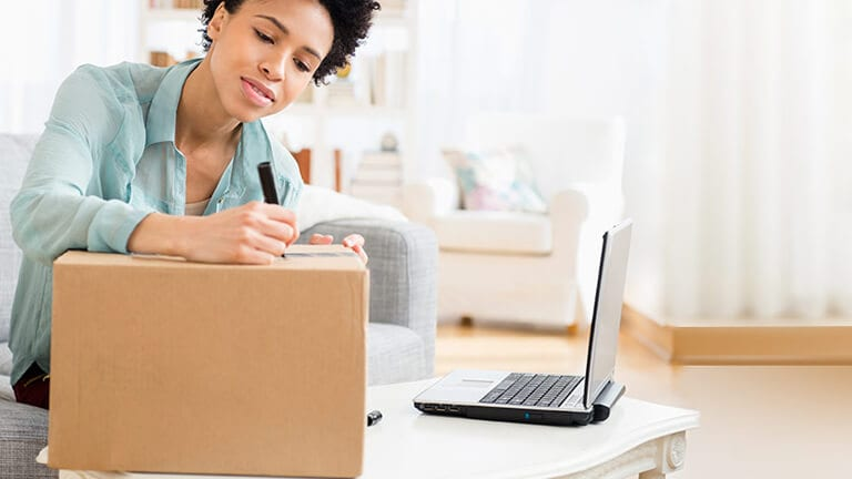 Woman writing on parcel