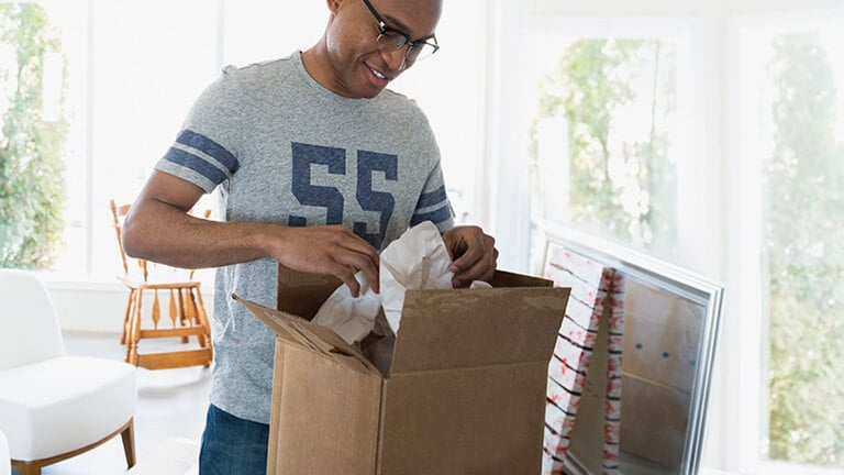 Man prepares parcel for return