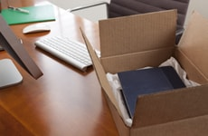 Open shipping package on a desk