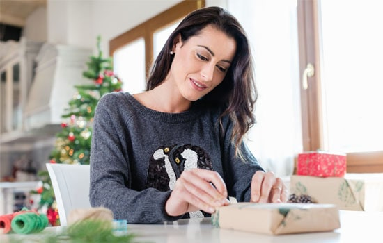 Woman wrapping a holiday gift