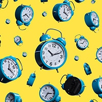 clocks against a yellow background