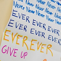 """Never give up"" written in colored markers"