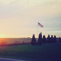 American flag next to sunrise