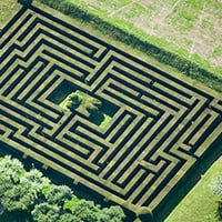 An aerial view of a maze made out of grass.