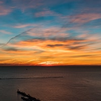 The sky glows with a beautiful sunrise over Lake Michigan in Chicago.