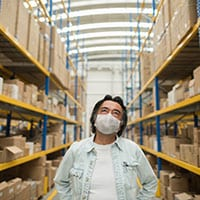 Man wearing mask in a warehouse