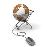 A globe in a shopping cart with a computer mouse next to it.