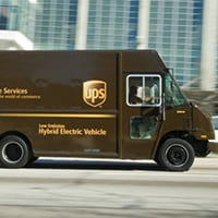 UPS Hybrid Electric Vehicle driving down city street