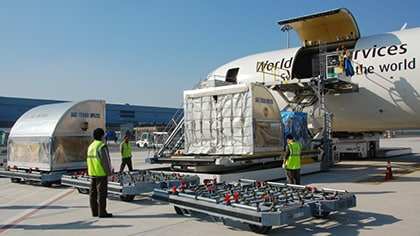 UPS Airline ground crew unload air freight from a UPS cargo jet.