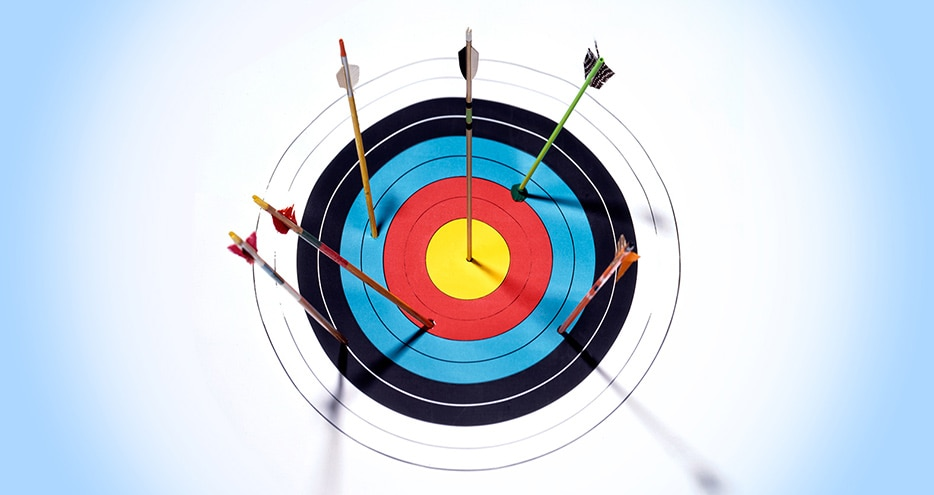 High Angle View Of Dartboard With Arrows