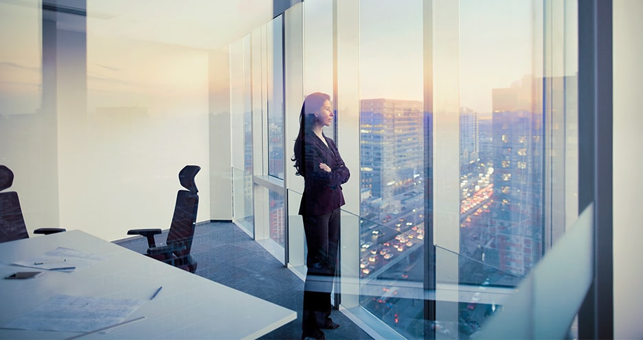 Businesswoman looking out window in meeting room
