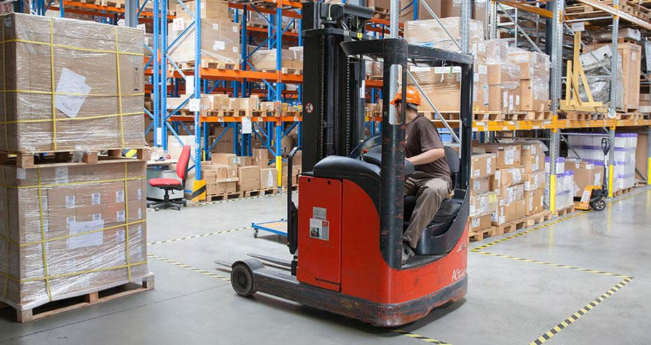 A forklift operates in a warehouse environment.