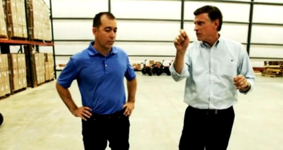 Monster Moto's Rick Sukkar discusses inventory issues with UPS's Mark Modesti in the company's new Louisiana warehouse
