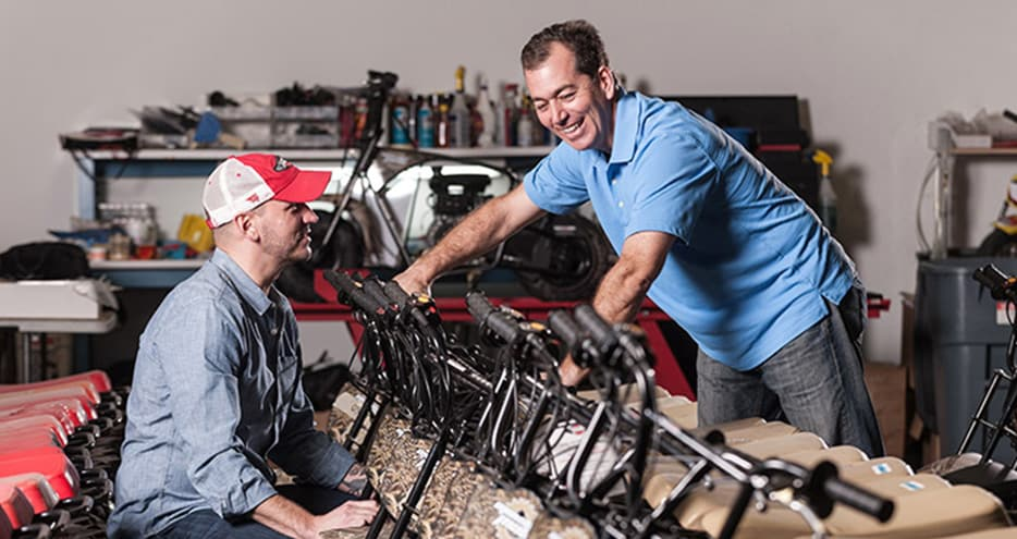 Alexander Keechle, CEO of Monster Moto, inspect a selection of the company's minibikes with COO, Rick Sukkar.