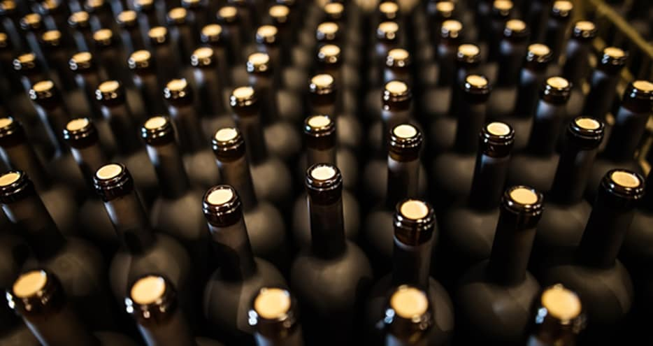Stacks of brown-hued wine bottles