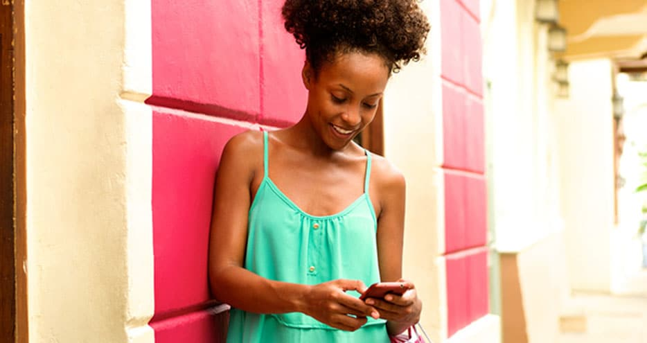 Young woman shops on her smartphone