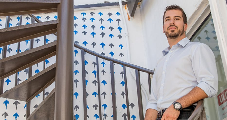Miansai e-commerce leader, Zack Simpson, shown on office spiral staircase