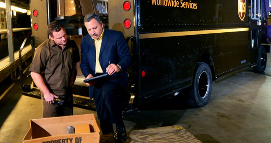 UPS's Jack Levis, who lead the ORION effort, discusses a route with a UPS driver