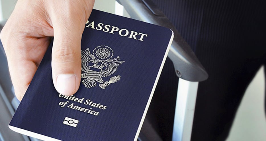 Traveler presents his U.S. passport