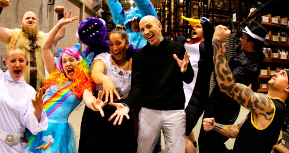 Tom Fallenstein, CEO of Halloween Costumes.com, is surrounded by colorfully costumed employees
