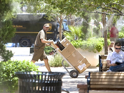 UPS driver picking up packages