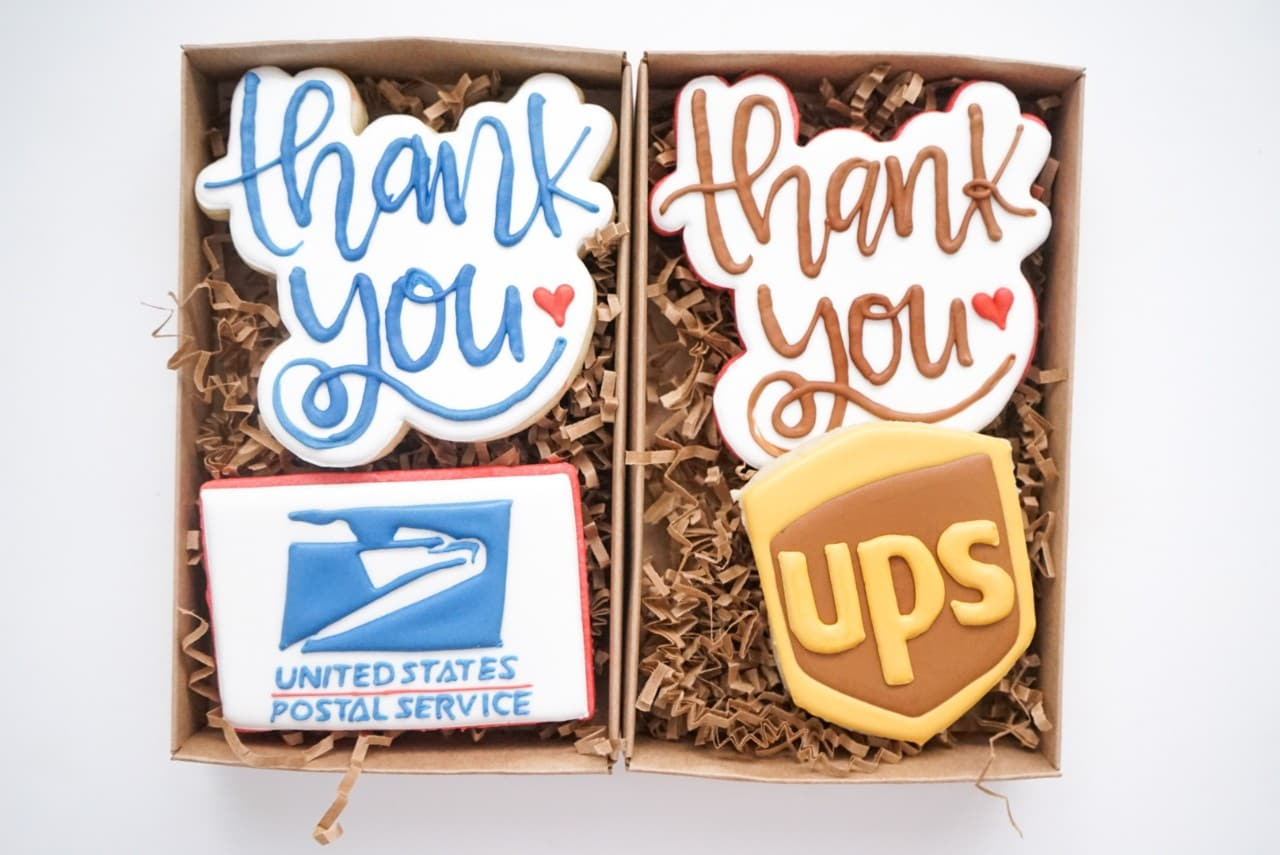 image of cookie art decorated to say 'Thank you' and the USPS logo and UPS logo