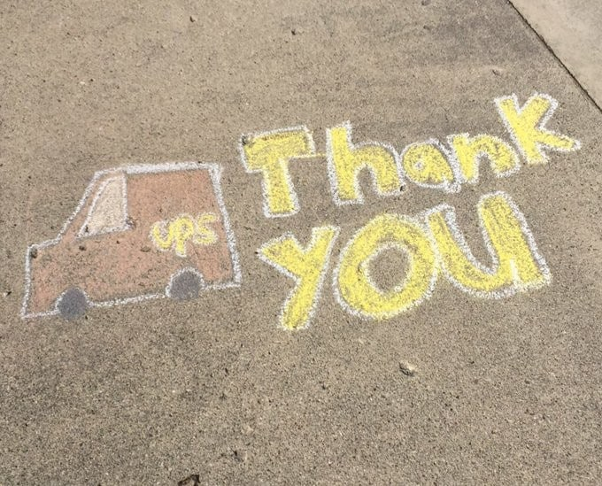 chalk art of a UPS truck with 'Thank you' written beside it