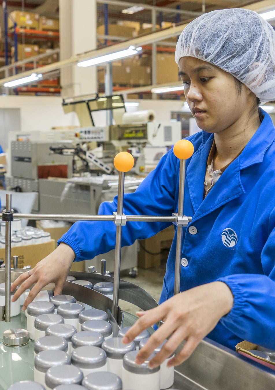 Woman working at pharmaceutical packaging center