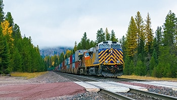 Cross-country freight containers traveling via railroad