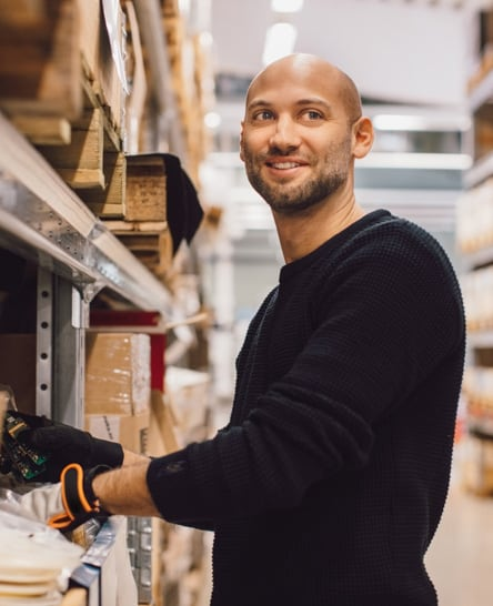 Warehouse worker picking spare parts for expedited fulfillment
